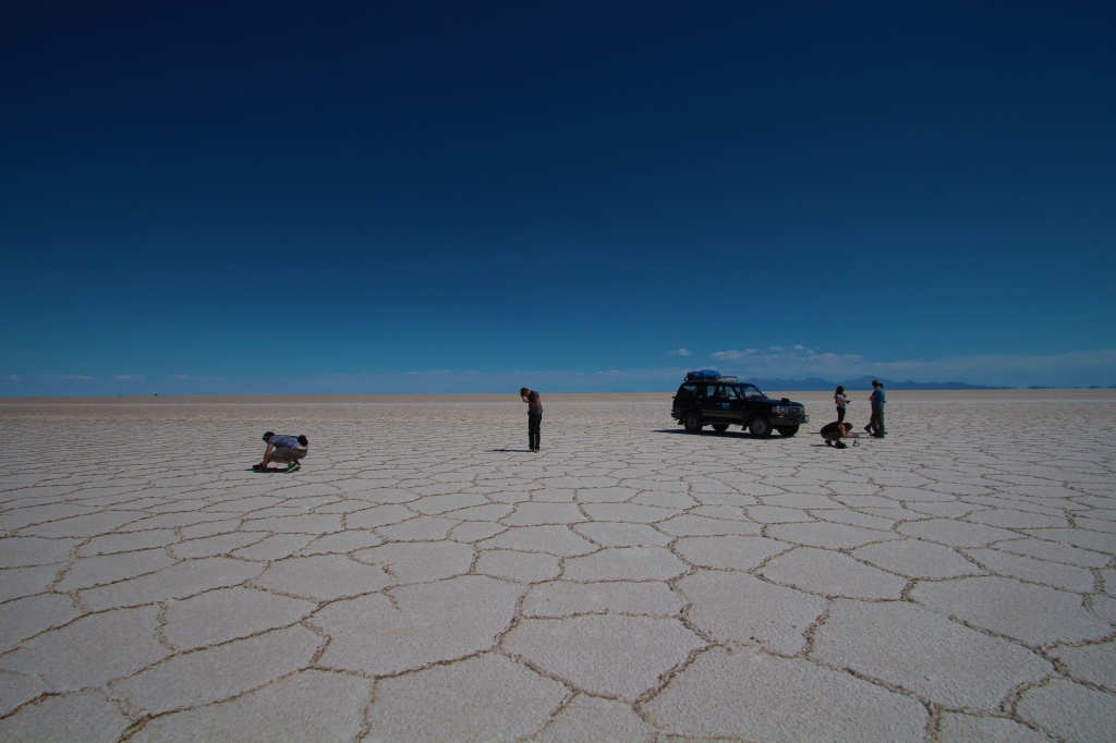 The crew and the Landcruiser in middle of Salar de Uyuni.
