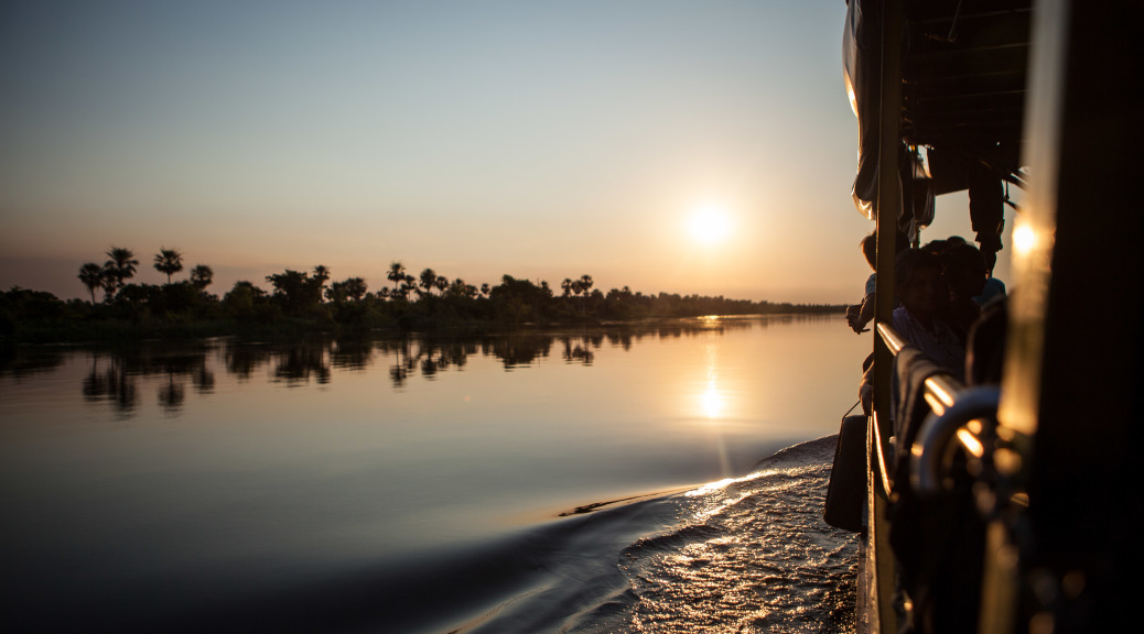 Riding the Dalma up the Rio Paraguay at sunset. To read more about our journey up the river, check out   http://wearebreakingborders.com/2014/09/24/the-dalma-bums/